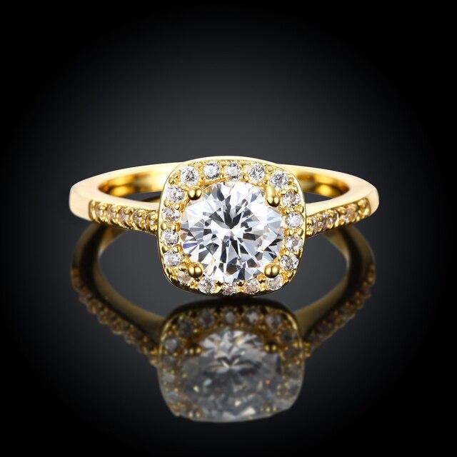 Фото женское кольцо с фианитом золотистое
