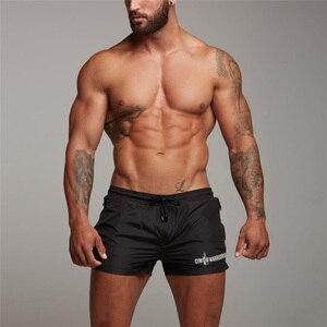 Новые мужские шорты для фитнеса бодибилдинга, мужские летние спортивные тренажеры, Мужская дышащая быстросохнущая спортивная одежда, бего...