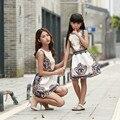 Madre e hija vestidos sin mangas floral princesa vestido de fiesta de la familia mirada de la muchacha y de la madre vestido de verano vestido a juego
