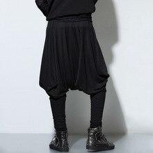 Punk rock masculino hiphop pantalones ocasionales de los hombres Pantalones  holgados bailarina falda Pantalones suelta Pantalone. eeb7b26335e