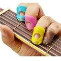 Envío Libre del dedo de introducción de la guitarra, guitarra dedo cuna, proteger el dedo para evitar el dolor de silicio materialZ53001