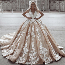 champagne wedding dresses 2019 lace appliques deep v neck ball gown dress sparkly bridal arabic