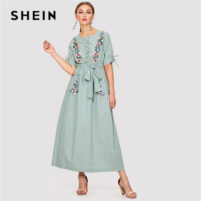 bddb9361930 SHEIN Floral Brodé Poche Hijab Robe Vert Col Rond Manches Courtes Femmes  Casual Maxi Robe 2018