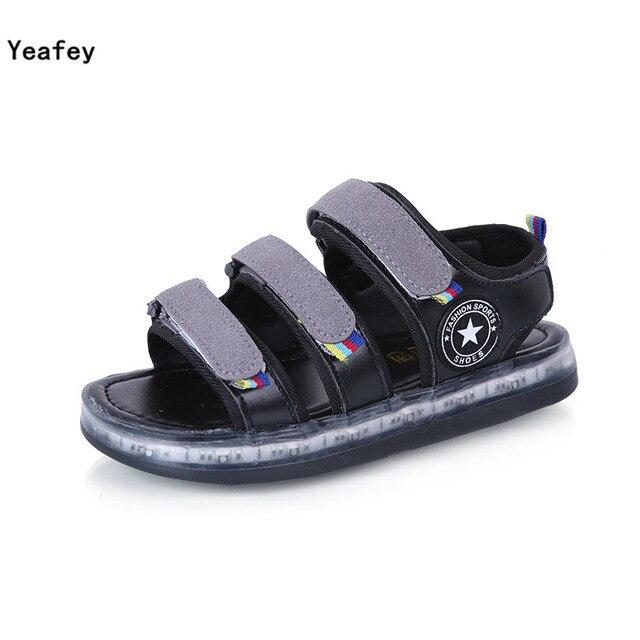 Yeafey Сандалии Девушка Свет Детская Обувь 2017 Черный Usb Детская Обувь светом Из Натуральной Кожи Мальчики Летние Девушки сандалии