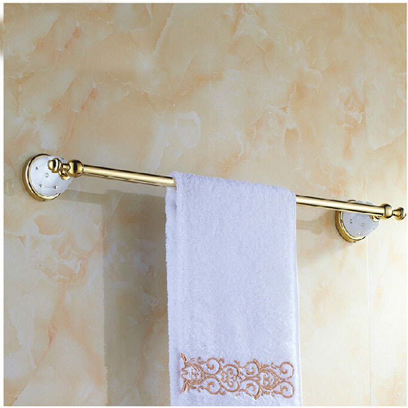 Wholesale and retail golden brass bathroom towel rack holder with diamond ceramic base w hook for Ceramic towel hooks for bathrooms