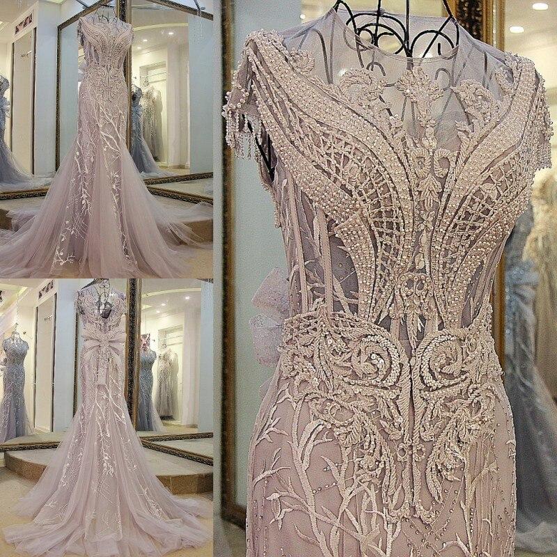 2017 tulle grigio chiaro cristalli di lusso Nappe cap maniche sexy in  rilievo illusione scollo disegno della sirena del vestito da sera xj01980  in 2017 ... 7b511309d5e