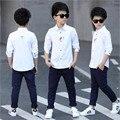 Promoción nuevo estilo inglés niños chicos camisetas de algodón 96% poliéster y 4% sólido camisas llenas de clothing