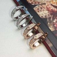 Gioielleria di alta qualità all'ingrosso di marca in acciaio inox doppia fila completa cz pietre orecchini per le donne degli uomini
