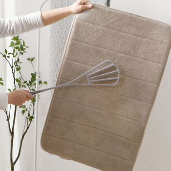 Plumero de plástico para el hogar con un pequeño cepillo para el...