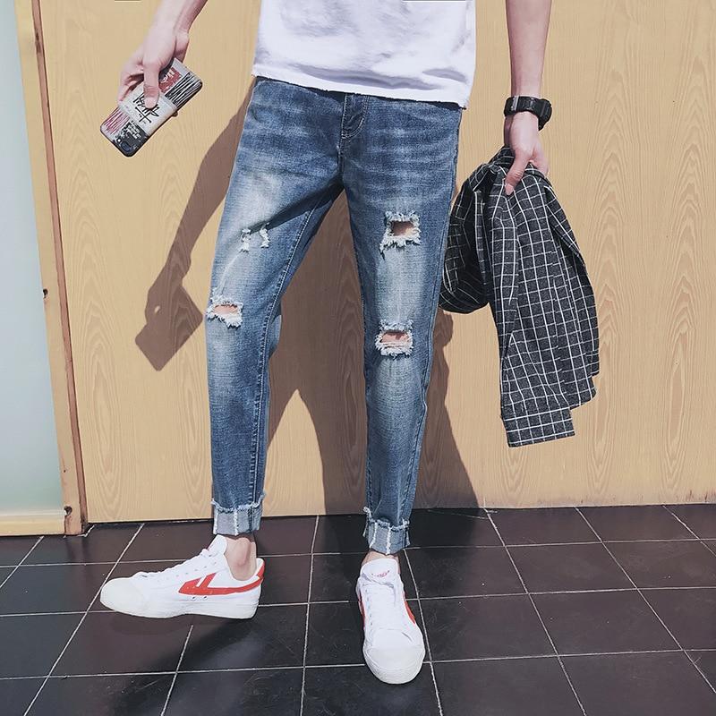 Spring / summer 2018 new mens jeans mens stretch slim pants mens cats must break holes in jeans mens