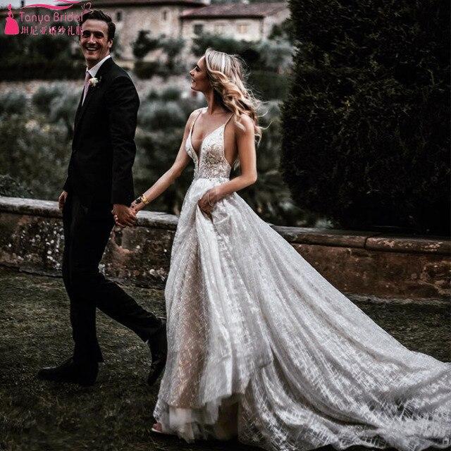 Striking Lace Wedding Dresses 2019 Fashion Bohemian Beach Bridal Gowns Deep  V-Neck Spain Beauty f76de6dbc812