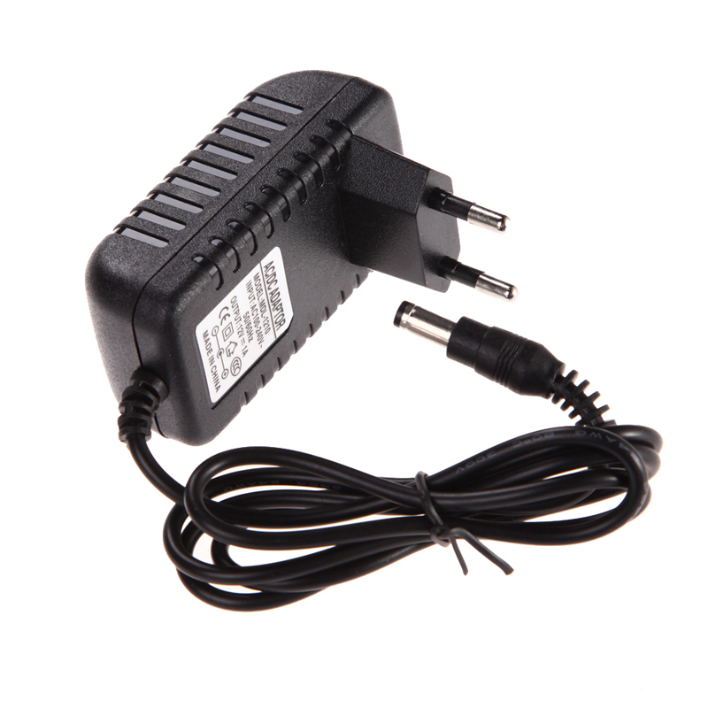 цена 100% New AC DC 5.5 x 2.5MM Adapter DC 12V 1A AC 100-240V Converter Adapter Charger Power Supply EU Plug Black