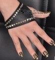 Nueva llegada para mujer de hip-Hop del semi-dedo guantes hembra sexy punk remaches de cuero negro guantes de rendimiento