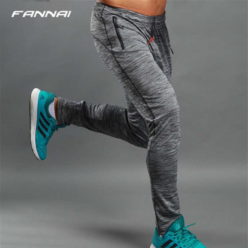 を実行している男性冬のジョギングパンツジムバスケットボールスポーツズボンジムフィットネススウェットパンツトレーニングトレーニング長ズボンスポーツウェア