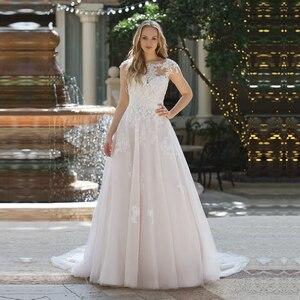 Image 1 - エレガントな A ラインチュールのウェディングドレスキャップスリーブブライダルドレスレースのアップリケ花嫁のドレス Vestido デ Noiva