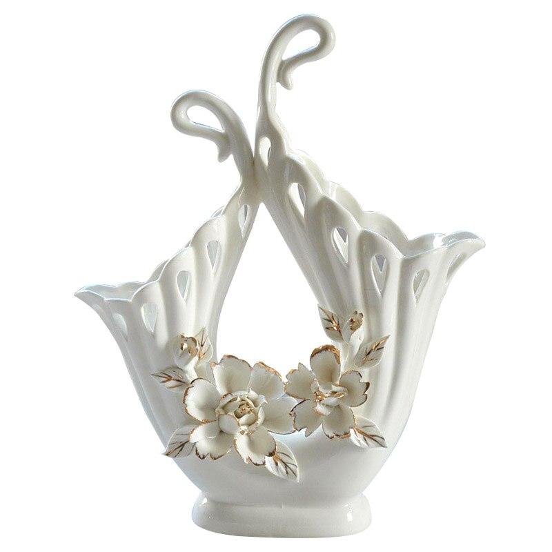 現代の創造的なセラミックアート花瓶家の装飾中空花瓶の装飾品デスクトップ工芸品リビングルームの装飾の結婚式のギフト  グループ上の ホーム&ガーデン からの 花瓶 の中 1