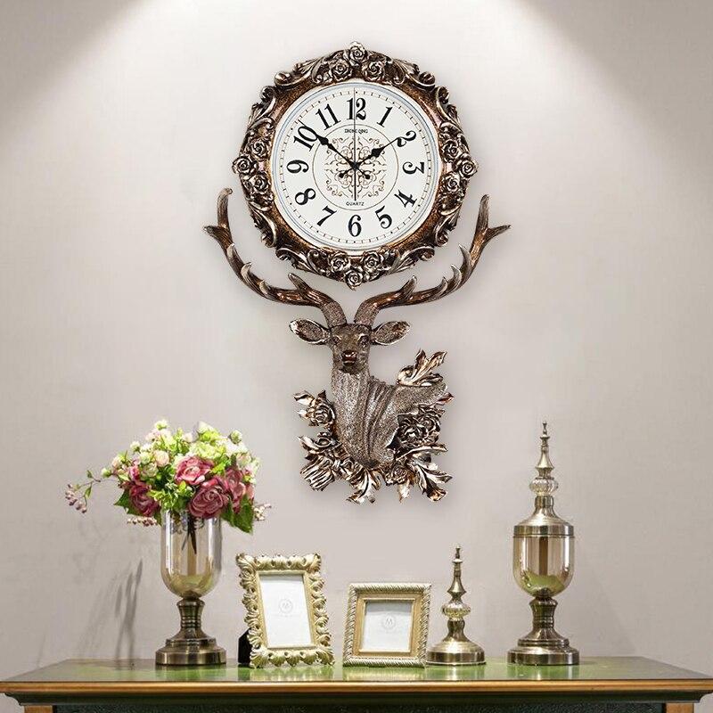 Reloj de estilo europeo para sala de estar, campana colgante, cabeza de ciervo, reloj de cuarzo de moda creativo, reloj decorativo de arte atmosférico Nórdico
