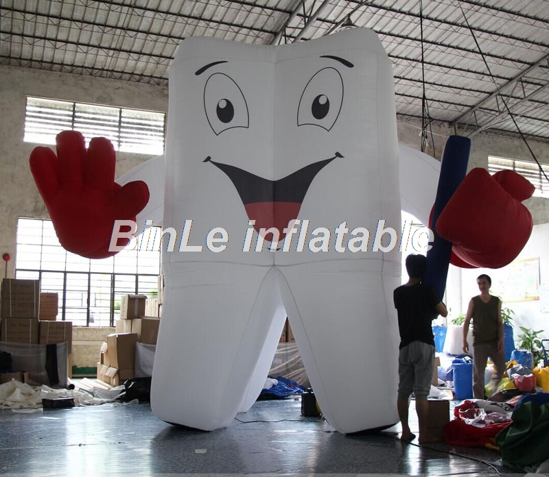 Custom made dental giant inflatable tooth balloon with toothbrush on hand for dentist's advertising image