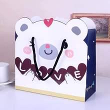 купить Emerra Hot Selling LOVE Bear Gift Bag  Candy hand-held paper bag kids toys Clothing Packaging Wholesale Free Shipping по цене 1628.28 рублей