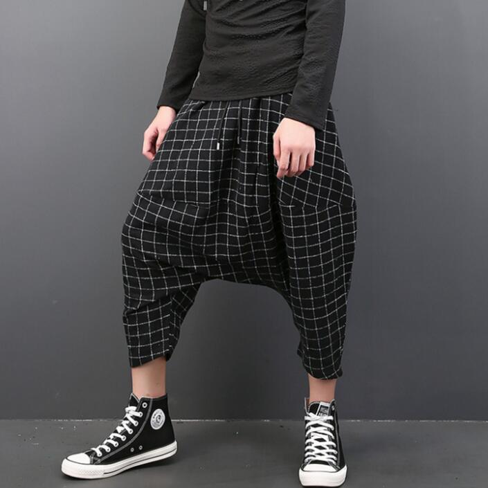 Automne hiver personnalité pantalon hommes bas entrejambe pantalon plaid sarouel hommes pieds pantalon mode pantalon homme rue noir