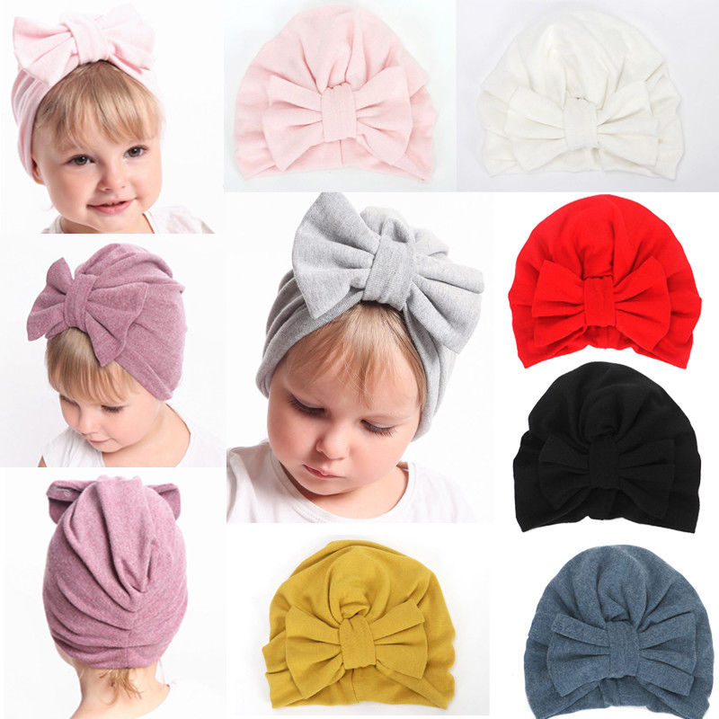 цена на Cute Newborn Toddler Kids Baby Boys Girls Turban Hat Winter Warm Fashion New Solid Bow Cotton Beanie Cap Baby Casual Cotton Hats