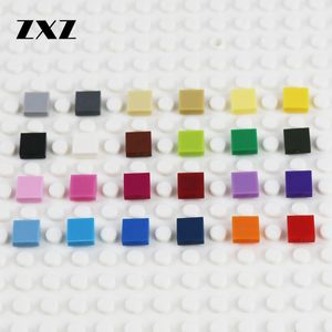 Image 1 - 2000pcs שטוח אריח 1x1 עם חריץ DIY אבני בניין QR קוד אביזרי צעצועי חלק MOC מכונית גמר אריח חלקי לבנים 3070