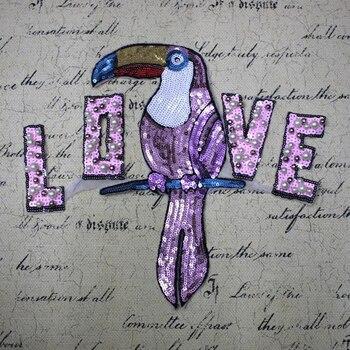 b68cc6d99 1 unidades púrpura grande loro con amor lentejuelas parches moda ropa  Applique DIY ropa coser en perlas para la ropa