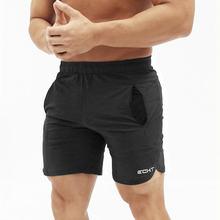 Verão Novos Homens Bezerro-Comprimento de Fitness Musculação Academias  Shorts Casual Praia Masculino Corredores Treino 8dfca3a21aeb9