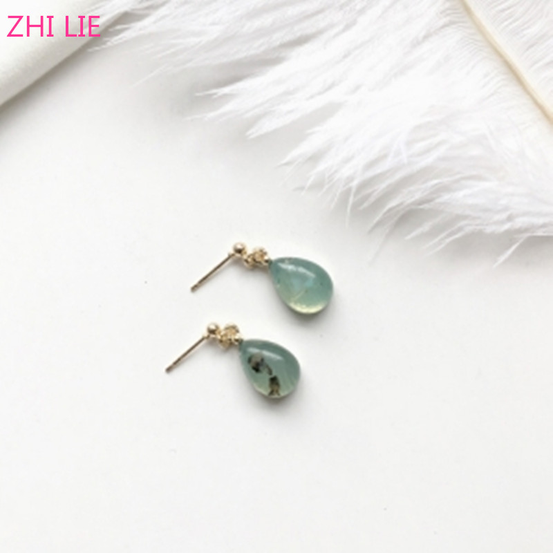 Korean version of the new personality simple white personality drops of water oval female  Earings Fashion Jewelry
