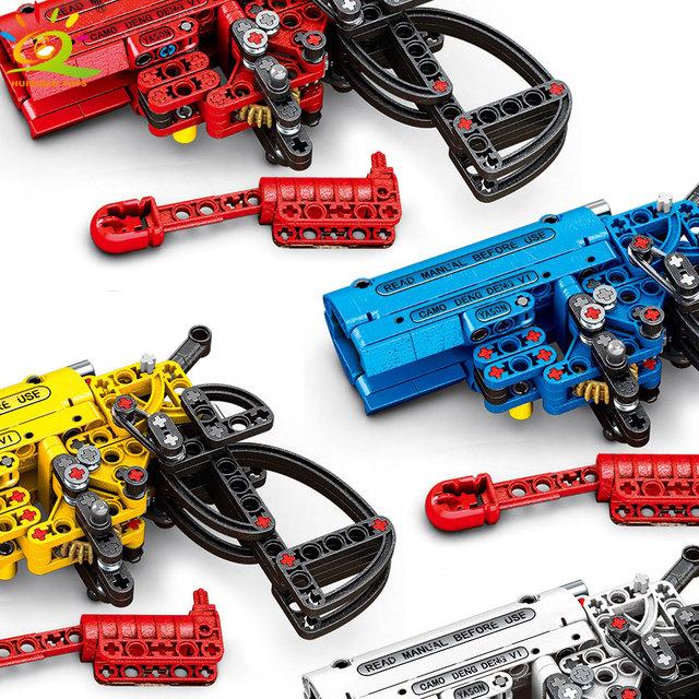 HUIQIBAO 4Color Shooting Signal Game Gun Building Blocks Technic Weapon DIY Bricks Educational Toys for Children boy GIFT