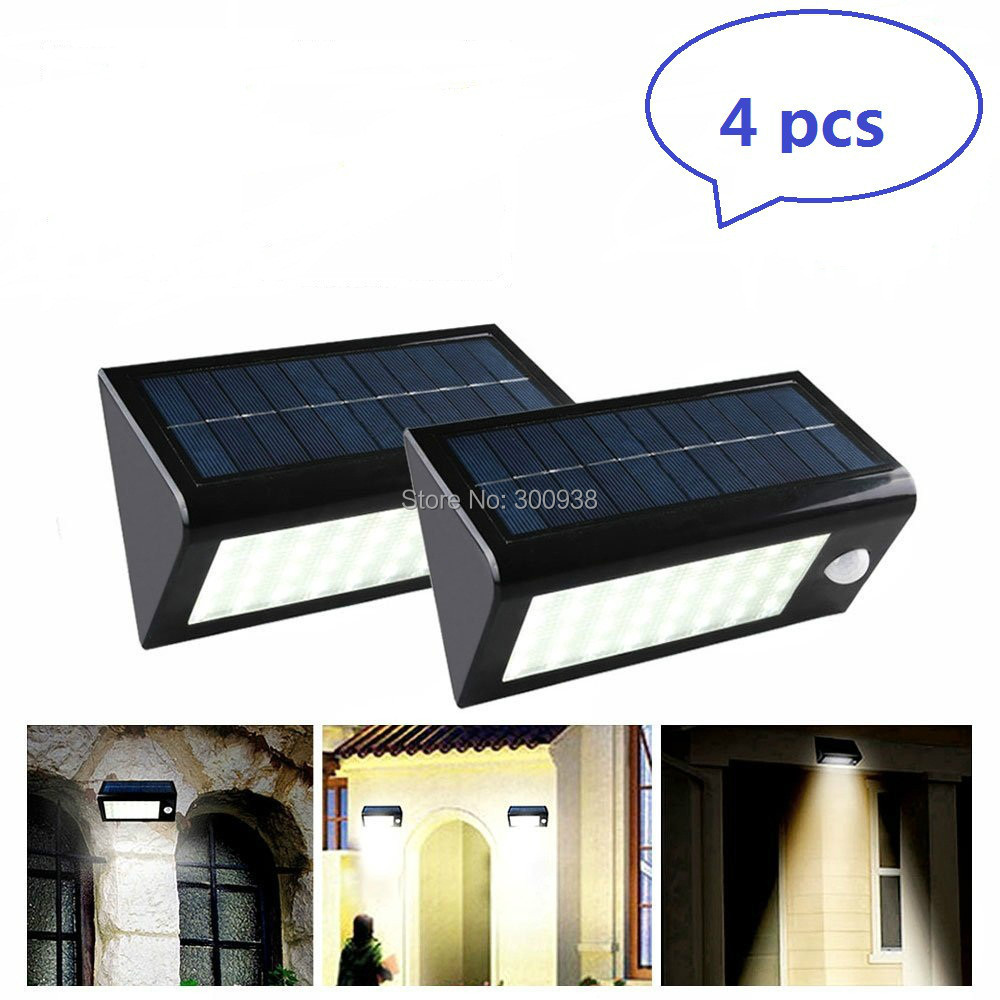 dhl free 4 pack outdoor 32 led solar motion sensor light. Black Bedroom Furniture Sets. Home Design Ideas