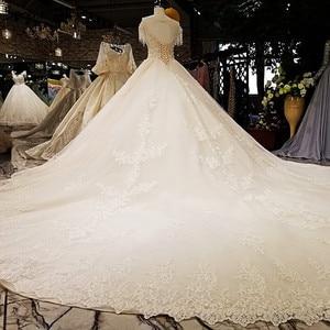 Image 2 - קיצוני יוקרה ללא שרוולים סקסי בציר חתונה שמלות 2020 קריסטל פרחי מותאם אישית high end טול הכלה שמלה