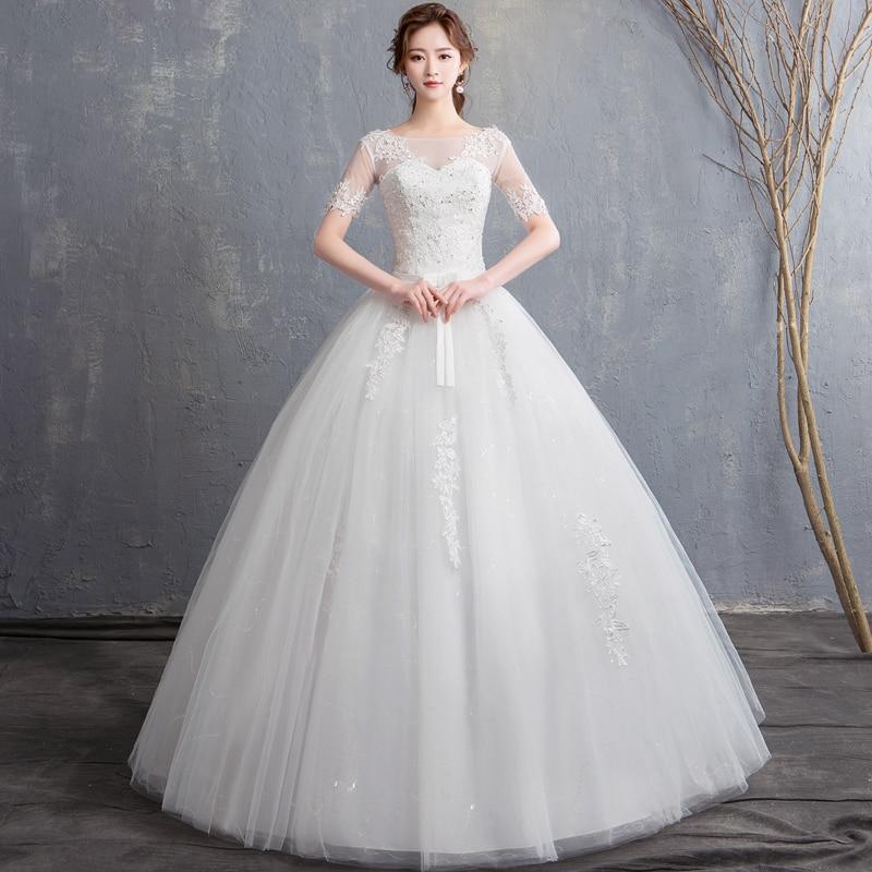EZKUNTZA 2019 New Vintage Wedding Dress Short Sleeve Elegant O Neck Lace Princess Wedding Dresses Lace Up Slim Wedding Dress L