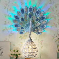 Modern Luxury Southeast Asia Colorful K9 Crystal Metal Bird Nest Lampshade Resin Peacock LED Wall Lamp for Background Aisle