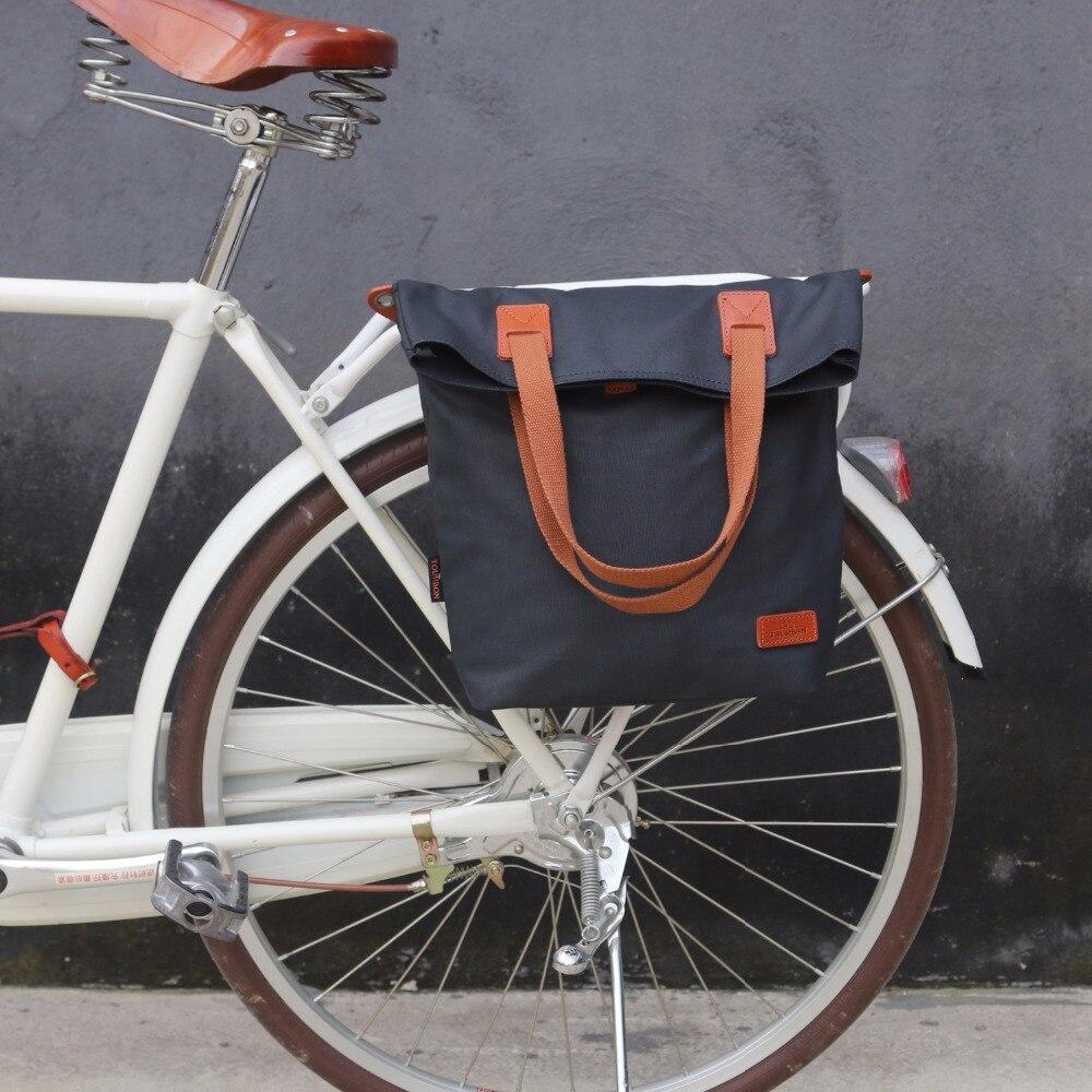 цена на Tourbon Vintage Bicycle Bag Waxed Canvas Waterproof Retro Bike Pannier Bags Cycling Rear Pack Seat Carrier Bags Deep Blue