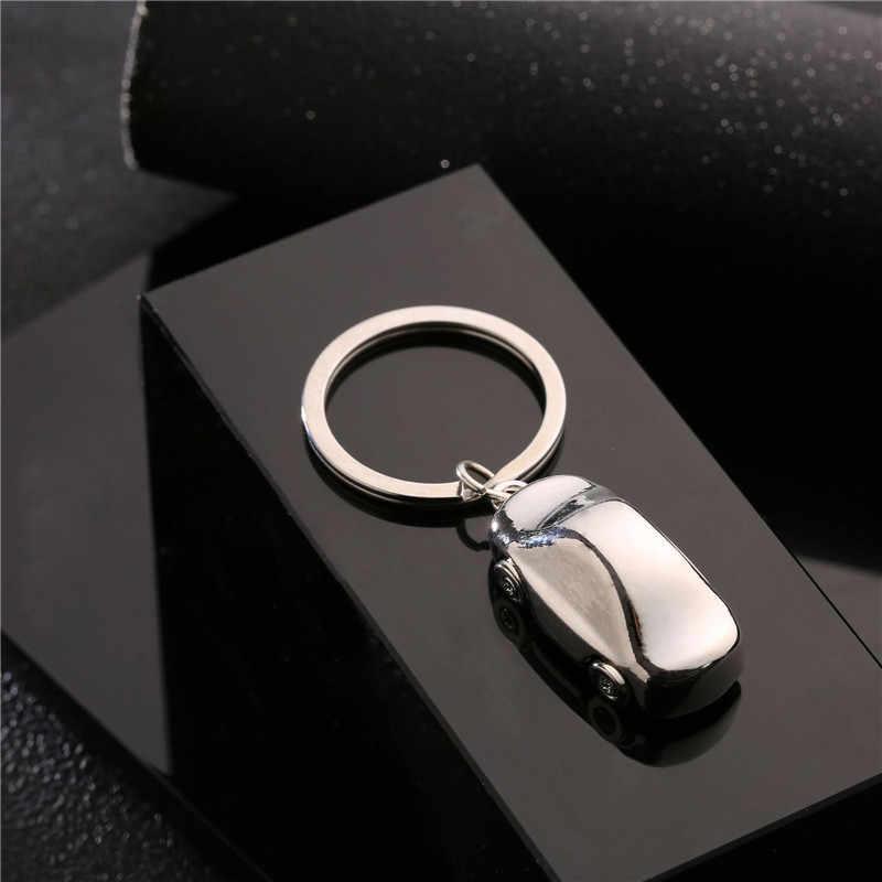 3D simulación Mini coche modelo llavero giratorio ruedas clave cadena anillos llavero de aleación de Zinc llave de soporte de moda regalos para los hombres