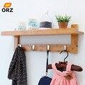 ORZ Bambus Wand Regal Mantel Haken Rack Mit 4 Legierung Haken Schlafzimmer Küche Bad Lagerung Organizer Halter Dekoration-in Haken & Leisten aus Heim und Garten bei