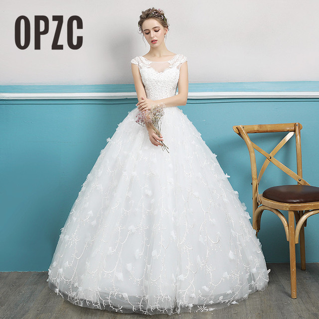 ffe944ec34c Real Photo 2018 White Wedding Dress Exquisite Lace Appliques Flower Beading  Ball Gown Luxury Sexy Bride Cap Sleeve Marriage