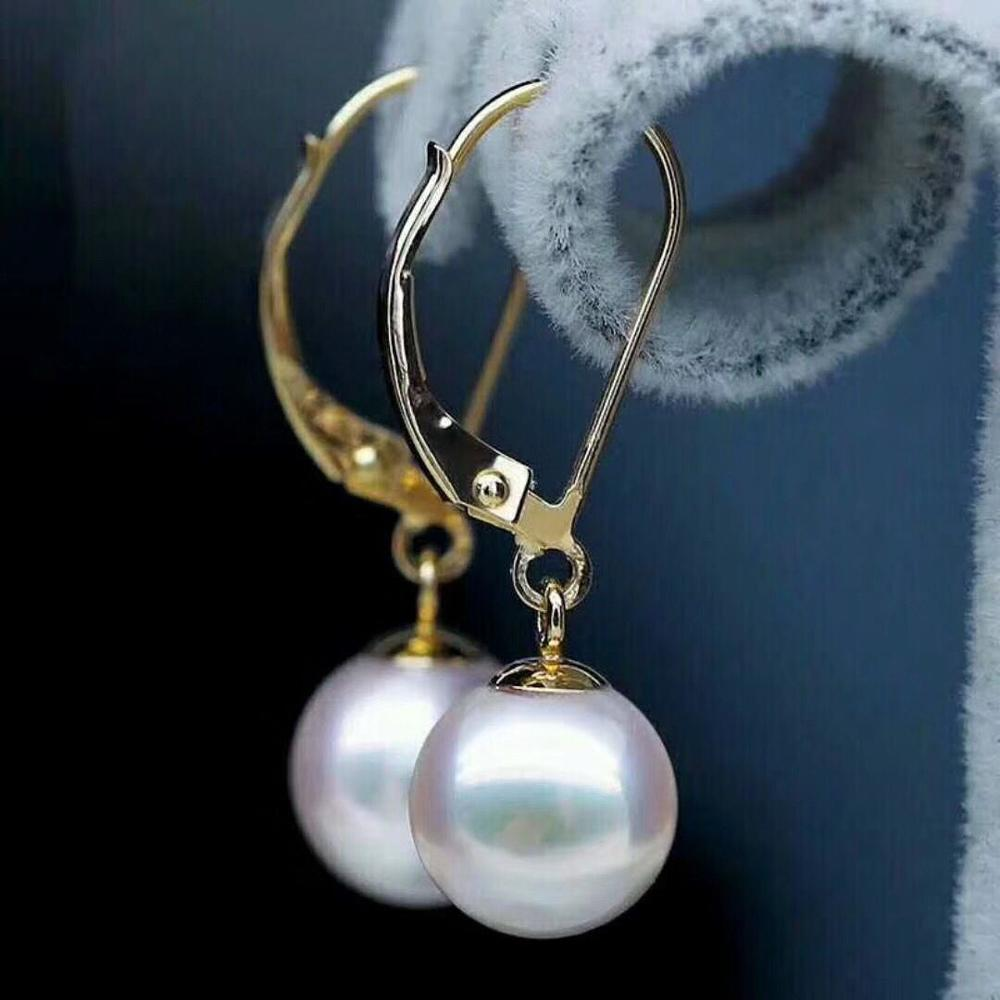 AAA 8-9 mm round natural south sea white pearl earrings 14 K gold