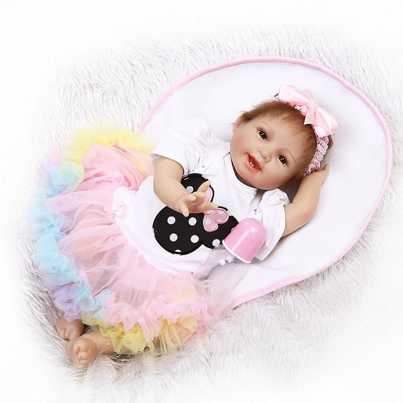 все цены на Drop ShiP 55cm Silicon Smile Babydoll Colorful Skirt Pink Bow Headband Early Childhood Toy