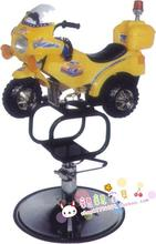 Children's bikes for haircut. The barber chair. Cartoon car a haircut.