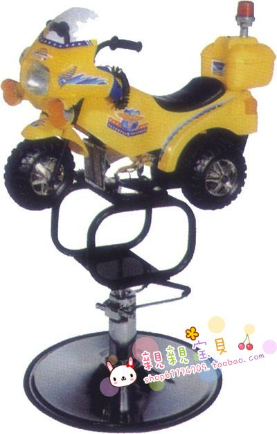 Children's bikes for haircut. The barber chair. Cartoon car a haircut.