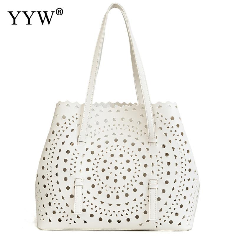 Hollow Out Handbags Female Shoulder Bag White WomenS Pu Leather Hand Bags Solid Top-Handle Bags For Women 2018 New DesignerHollow Out Handbags Female Shoulder Bag White WomenS Pu Leather Hand Bags Solid Top-Handle Bags For Women 2018 New Designer