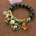Free shipping 2015BJ The charm of personality trend of the new black beads teapot gold bracelet woman