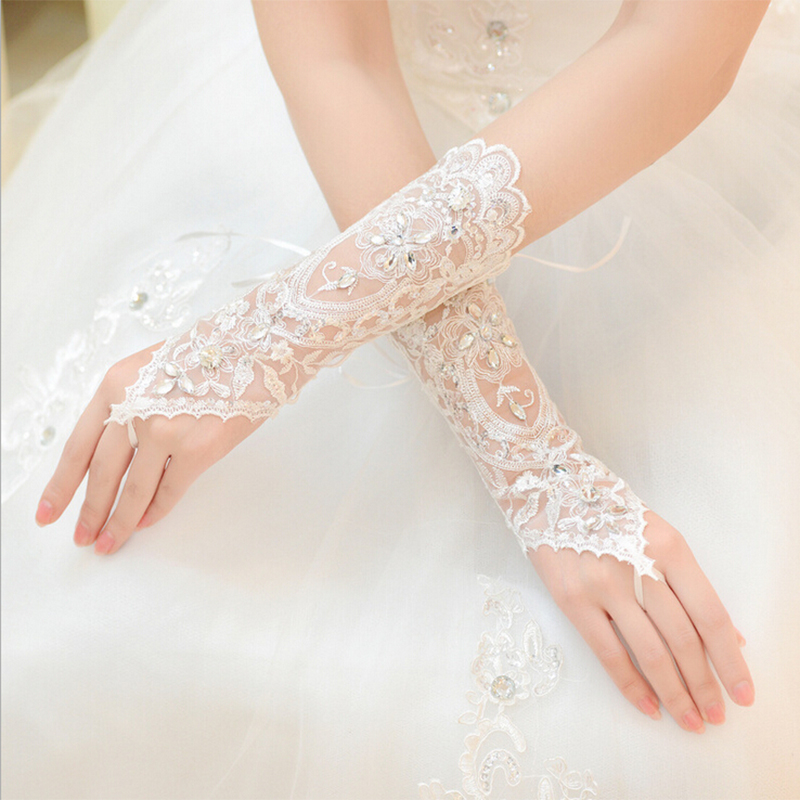 Fansmile Cheap Free Size White Fingerless Rhinestone Lace Bridal Wedding Gloves Free Shipping Wedding Accessories Made In China
