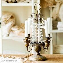Candelabro de mesa de metal dorado vintage de 4 brazos con cristales colgantes
