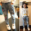 Free shipping.The spring and autumn kids clothing casual jeans pants, Cartoon image girls jeans, girl ripped jeans.