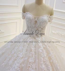 Image 5 - Amanda Design abiti da sposa Off Schulter Kurzarm Spitze Appliqued Pailletten Hochzeit Kleid