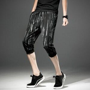 Image 3 - شحن مجاني جديد الذكور الرجال رجل الأزياء اقتصاص السراويل الصيف كبيرة الحجم الكورية أسود فضفاض رقيقة العجل طول السراويل