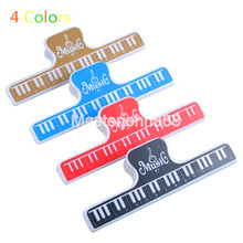 лучшая цена Mater John Music Book Note Paper Ruler Sheet Music Spring Clip Holder For Piano Guitar Violin Viola Cello Performance Practice